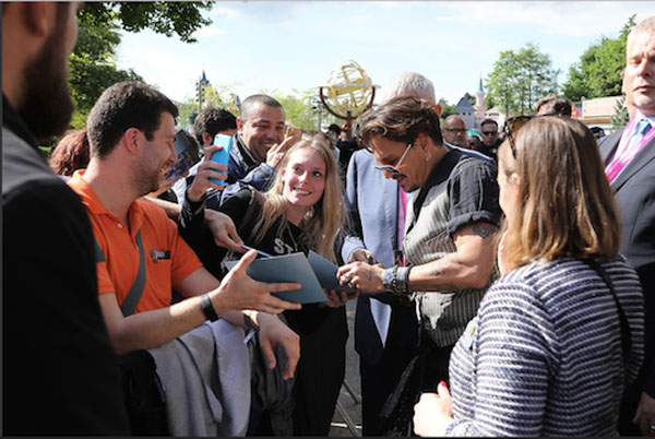 Johnny Depp enjoys the company of guests and signs autographs