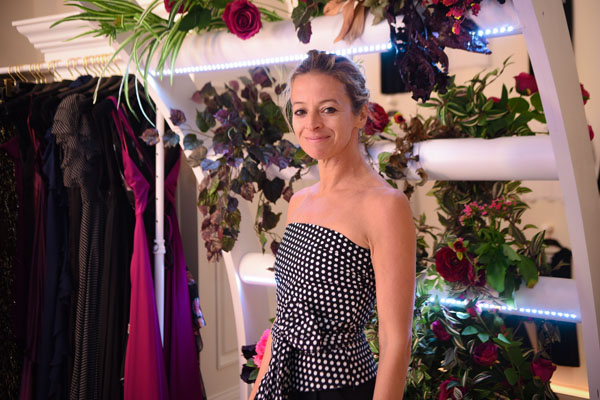 Milly Co-Founder Michelle Smith in front of her couture line during the Pop-Up Shop