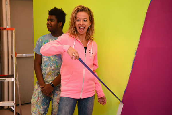 Milly Co-Founder Michelle Smith ripped off the final pieces of tape on the Pop-Up Shop wall